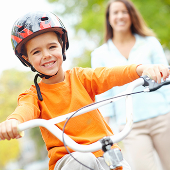 Smiling child on bicyle photo